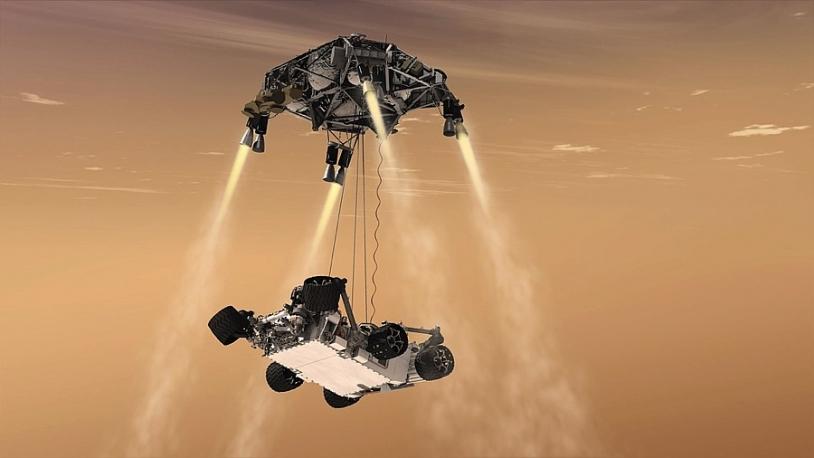 Phase finale de la descente de Curiosity vers le sol martien. Crédits : NASA/JPL-Caltech.