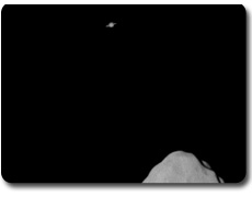 Lutetia et Saturne en arrière plan
